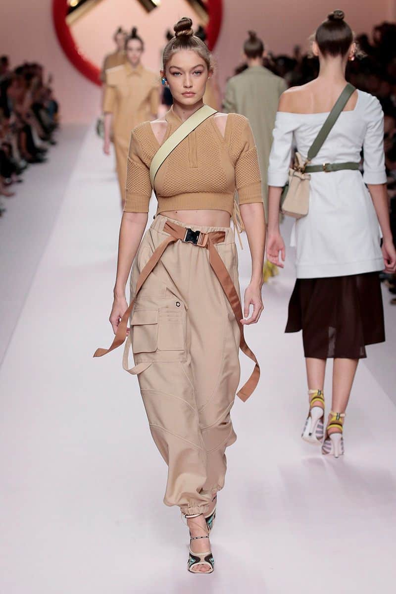 model in crop top and trousers with pockets
