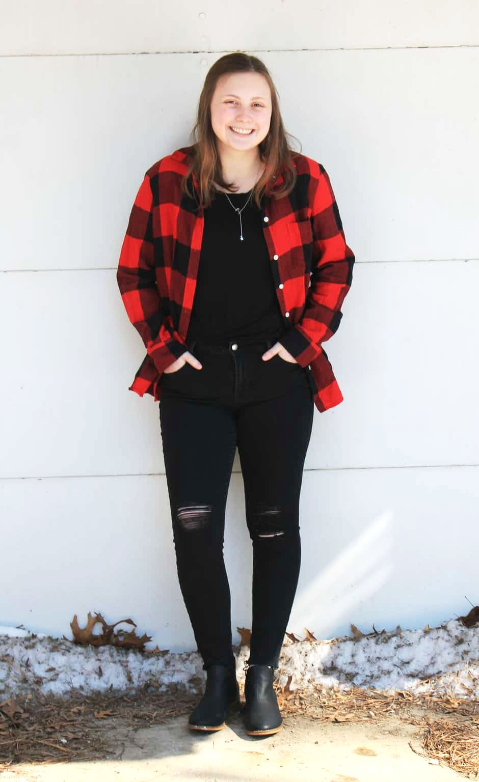 GVSU fashion: Student Genna wears a red and black plaid shirt with ripped black jeans and a black top