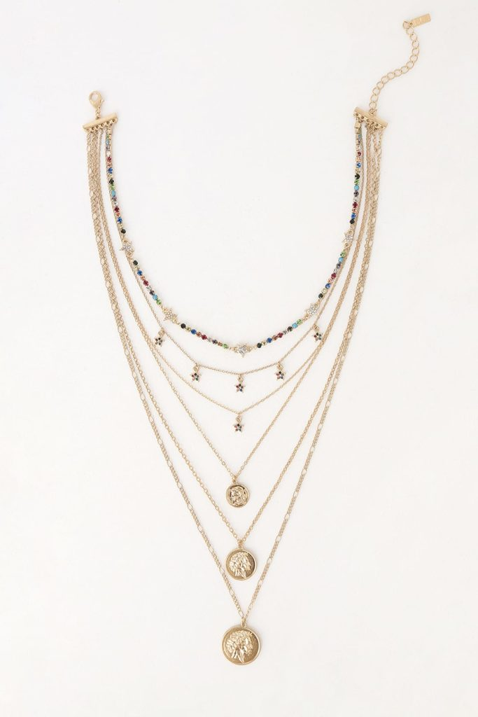 Layered gold necklace with stars