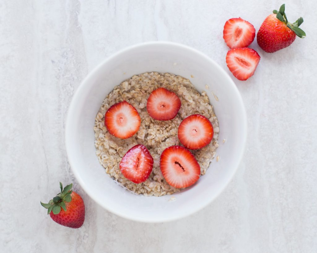 Bowl of oatmeal with strawberries