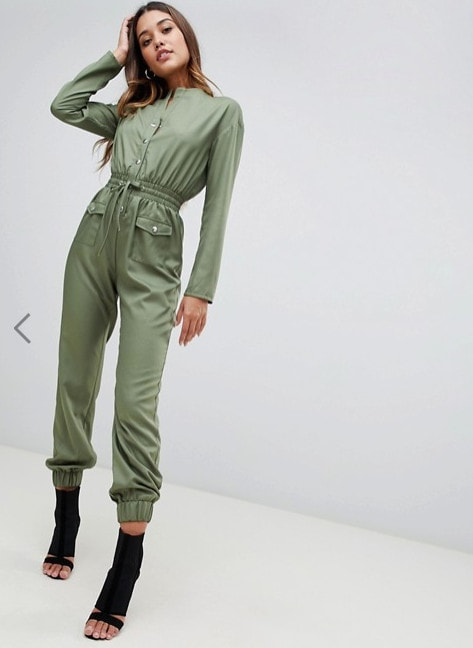 model in flight suit with pockets and heeled booties