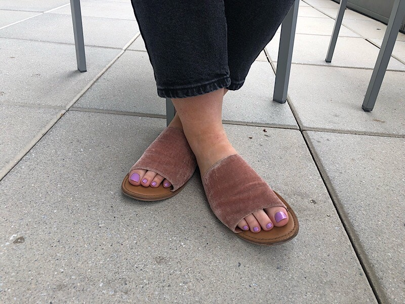Ali's slide sandals from Target are made of blush velvet.