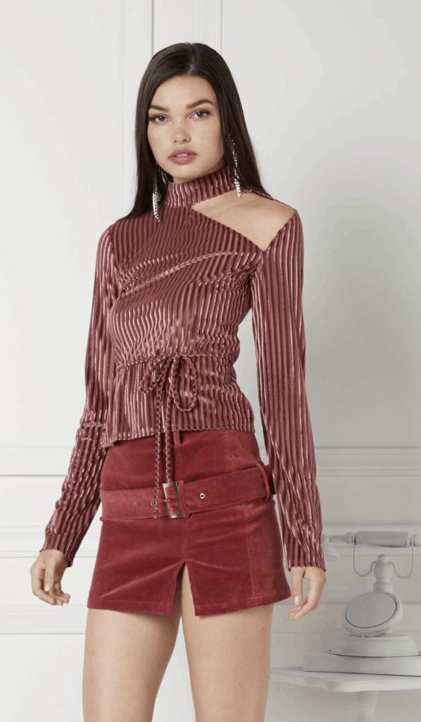 model wearing a velvet corduroy blouse and mini skirt