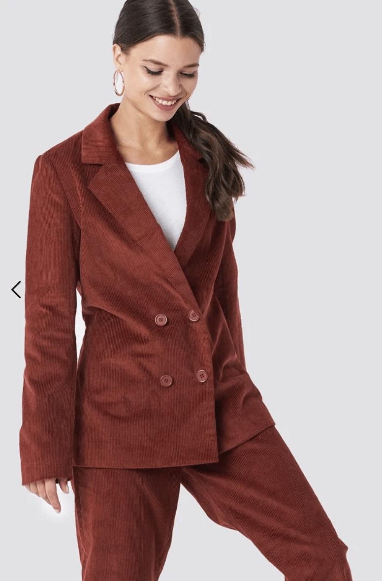model wearing a brown corduroy suit
