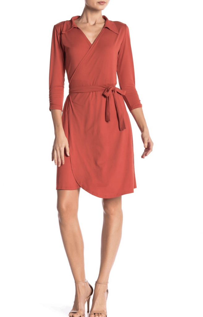 model in rust colored wrap dress