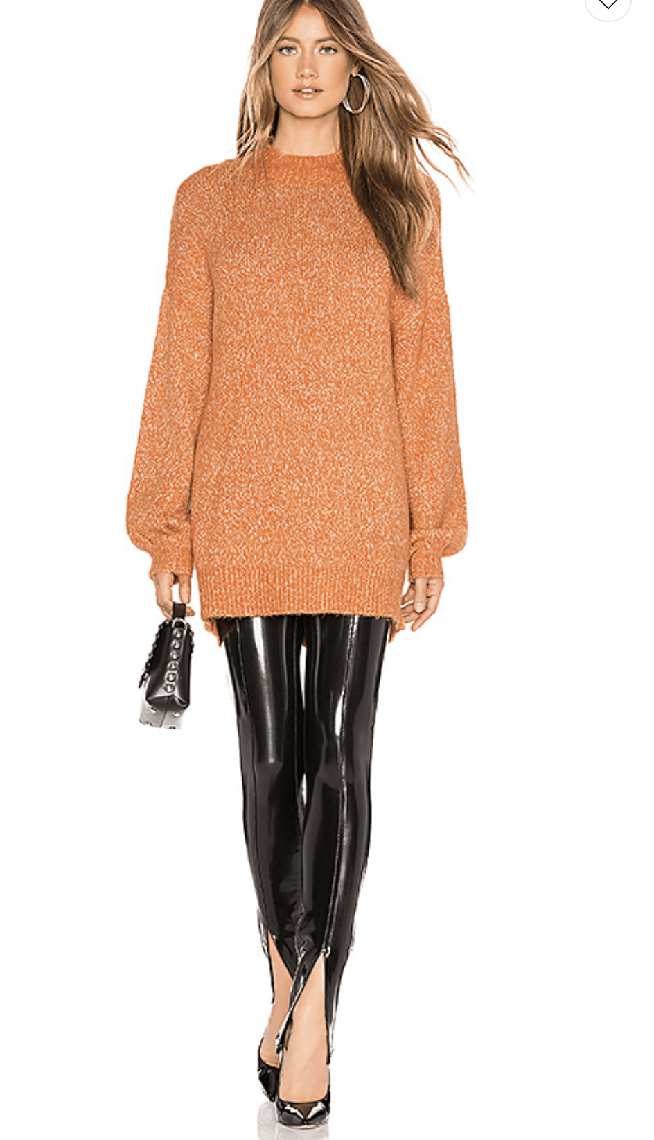 model wearing a orange sweater, leather leggings, black pumps and black handbag
