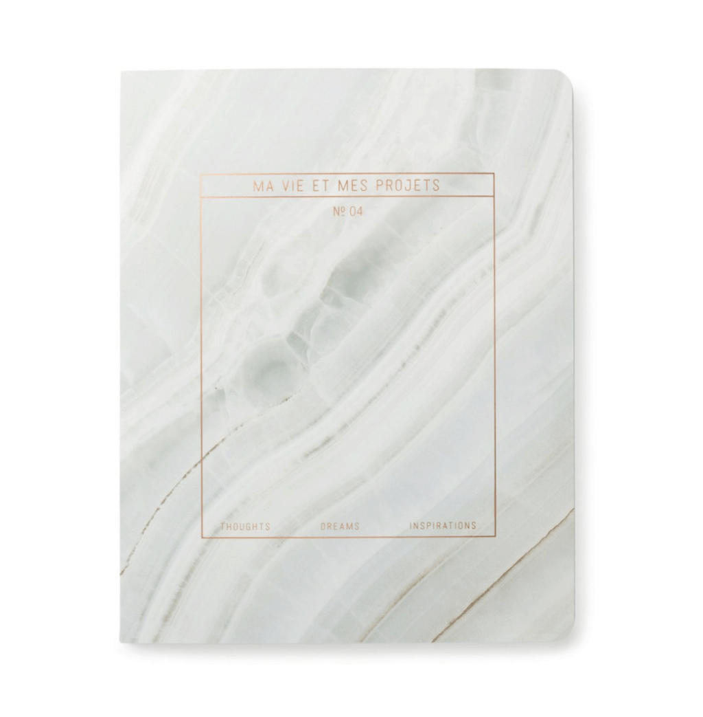 white and grey marble notebook