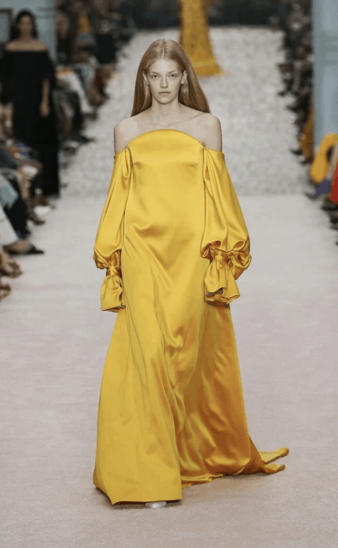 model in strapless long sleeve gown