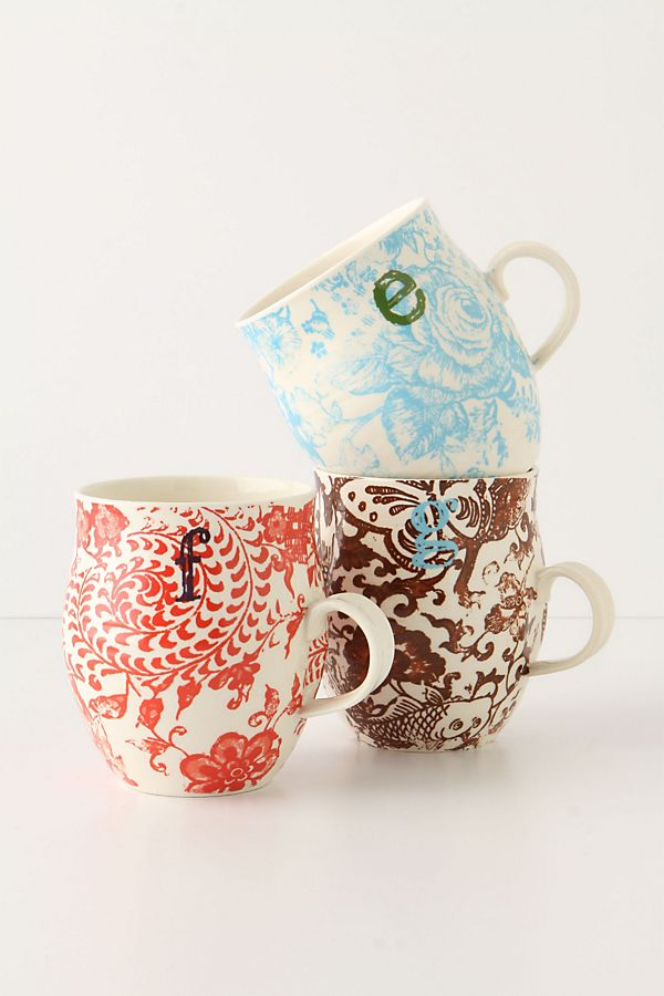 Three assorted printed monogram mugs in letter