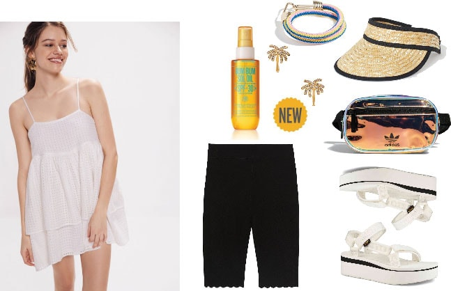 Music festival inspired outfit with bike shorts, strappy dress, flatforms, fanny pack, visor