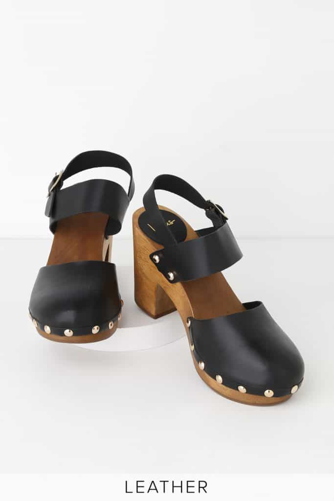 Black heeled wooden clogs with silver studs