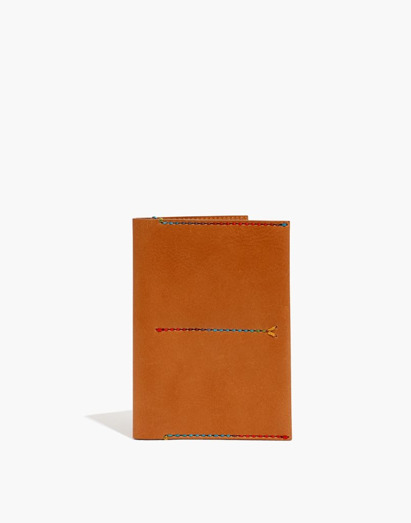 Cognac brown leather passport holder with rainbow-colored stitching