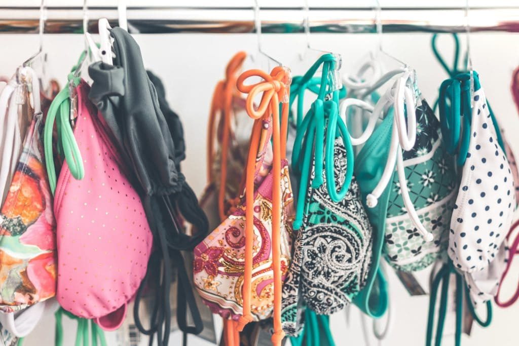 Multicolored bikinis hanging on rack