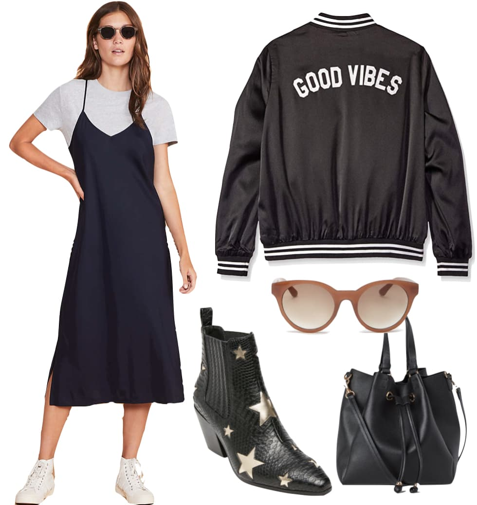 Jamie Chung Outfit: navy midi slip dress, Good Vibes graphic bomber jacket, neutral colored plastic sunglasses, black and metallic start print booties, and black bucket bag