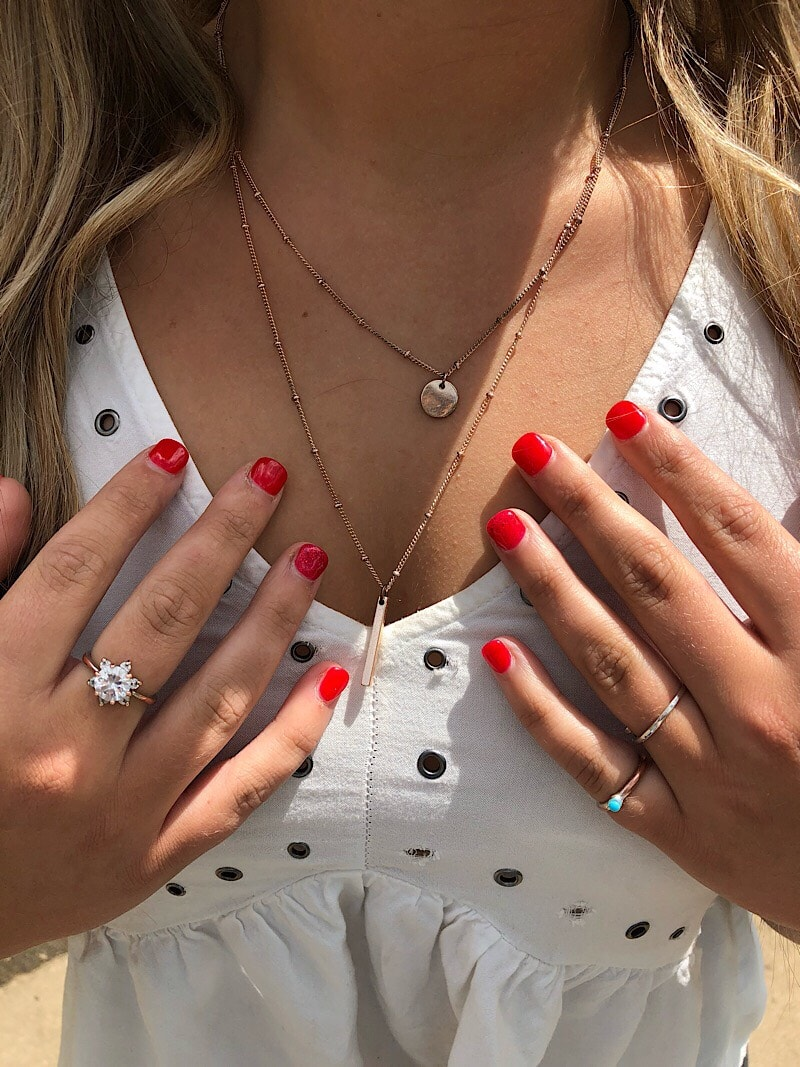 Kelsey wears mixed metals; layered gold necklaces as well as gold and silver rings.