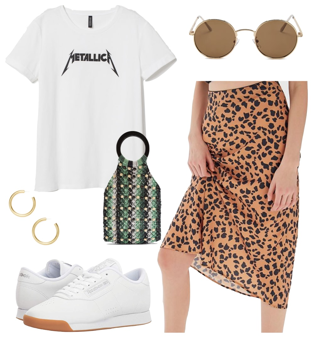 Laura Harrier Outfit: white and black graphic band t-shirt, leopard print satin midi skirt, round sunglasses, green crochet top handle bag, white low top sneakers and chunky gold hoop earrings