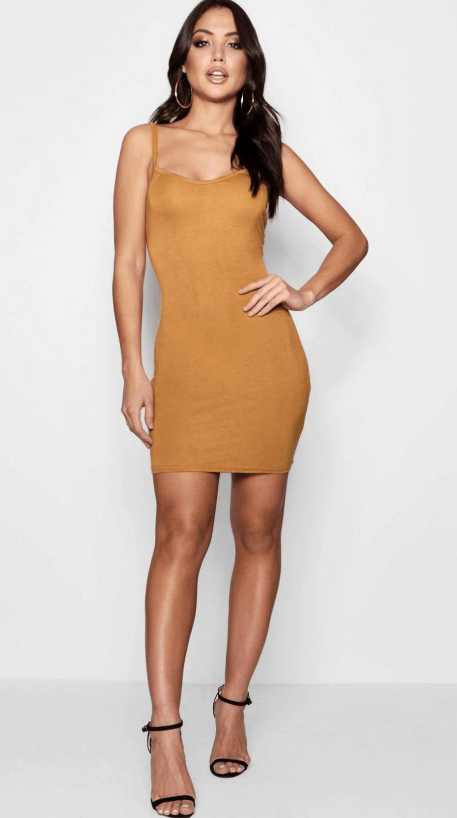 model in mustard yellow tank dress