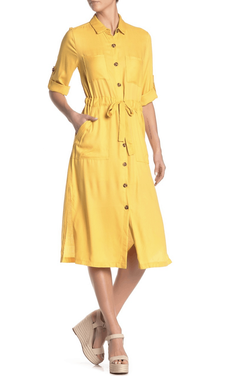 model in yellow button up dress