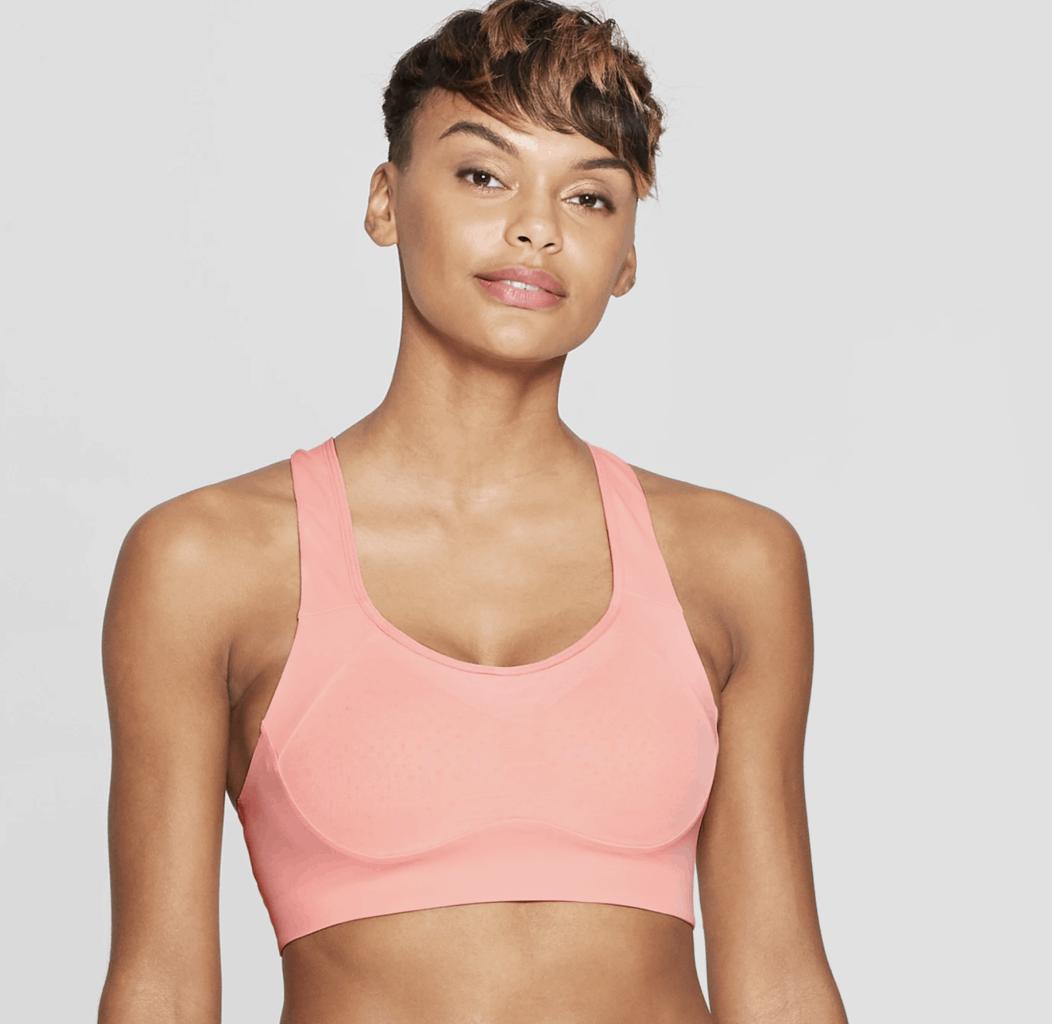 model in pink sports bra