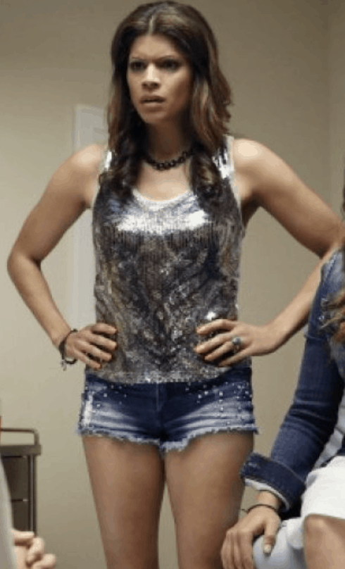 Xiomara from Jane the Virgin wearing a sequin top and studded jean shorts