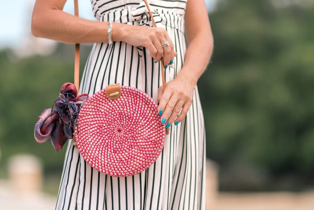How to create your own unique wardrobe - photo of a woman with circle bag and blue nails