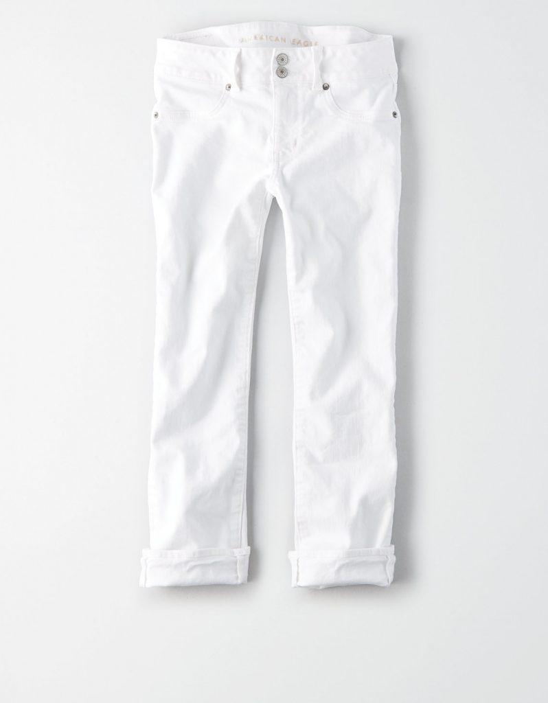 White denim capri pants rolled up.