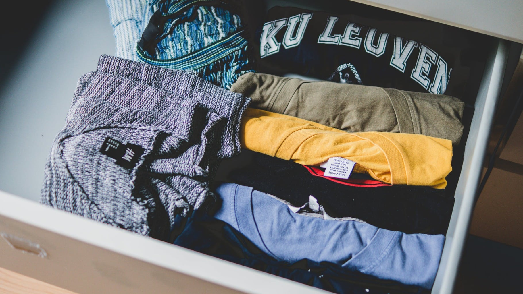 Drawer filled with folded t-shirts