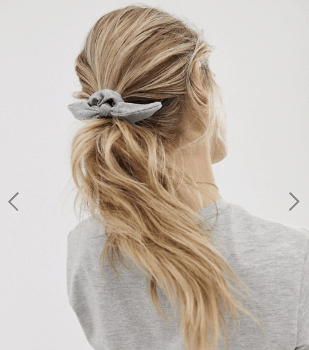 model wearing bow hair scrunchie