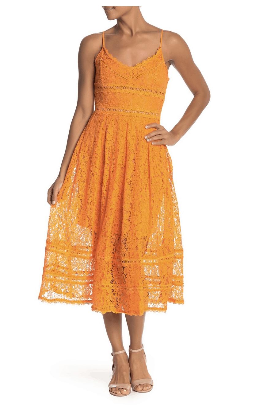 model in orange lacy dress