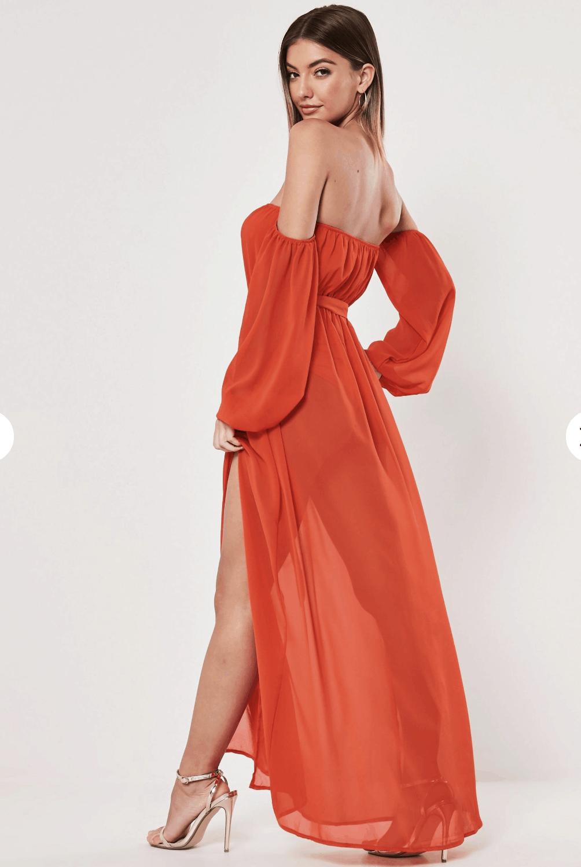 model in orange maxi dress
