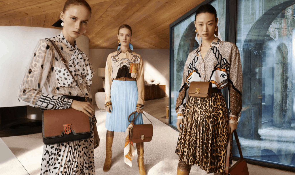models in mixed print outfits and brown leather bags.