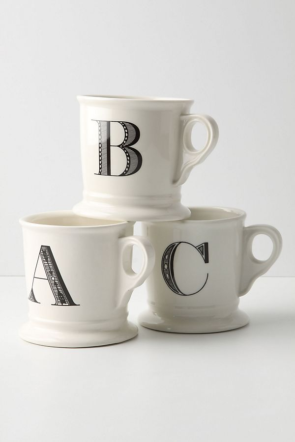 Three off-white monogram mugs featuring capital letters