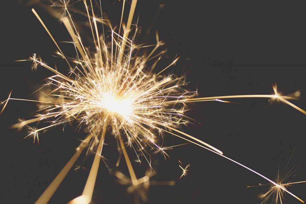 Holding lit firework
