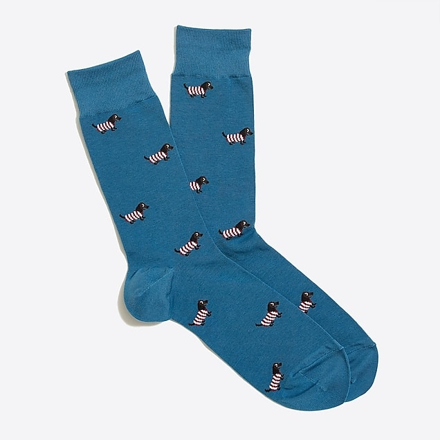 Medium teal-blue socks with design featuring small Dachshunds in striped sweaters