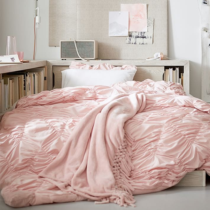 Pink ruffle comforter with pink blanket