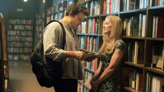 Amy Dunne in Gone Girl wearing a floral dress