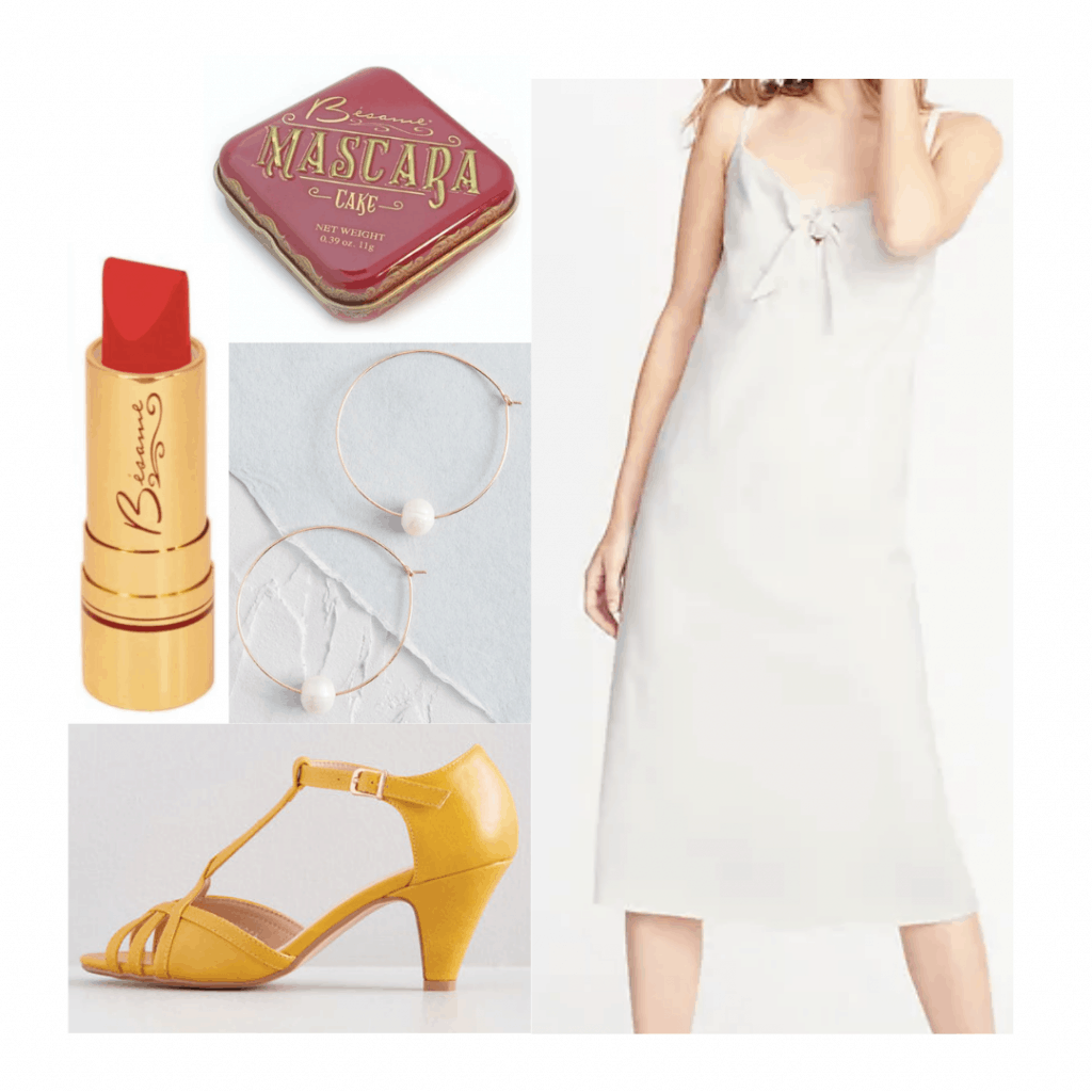 1920s fashion inspired outfit with white slip dress, yellow heels, lipstick, pearl earrings