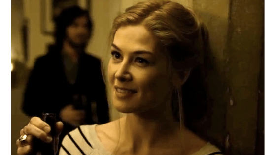 Amy Dunne in Gone Girl wearing a striped sweater