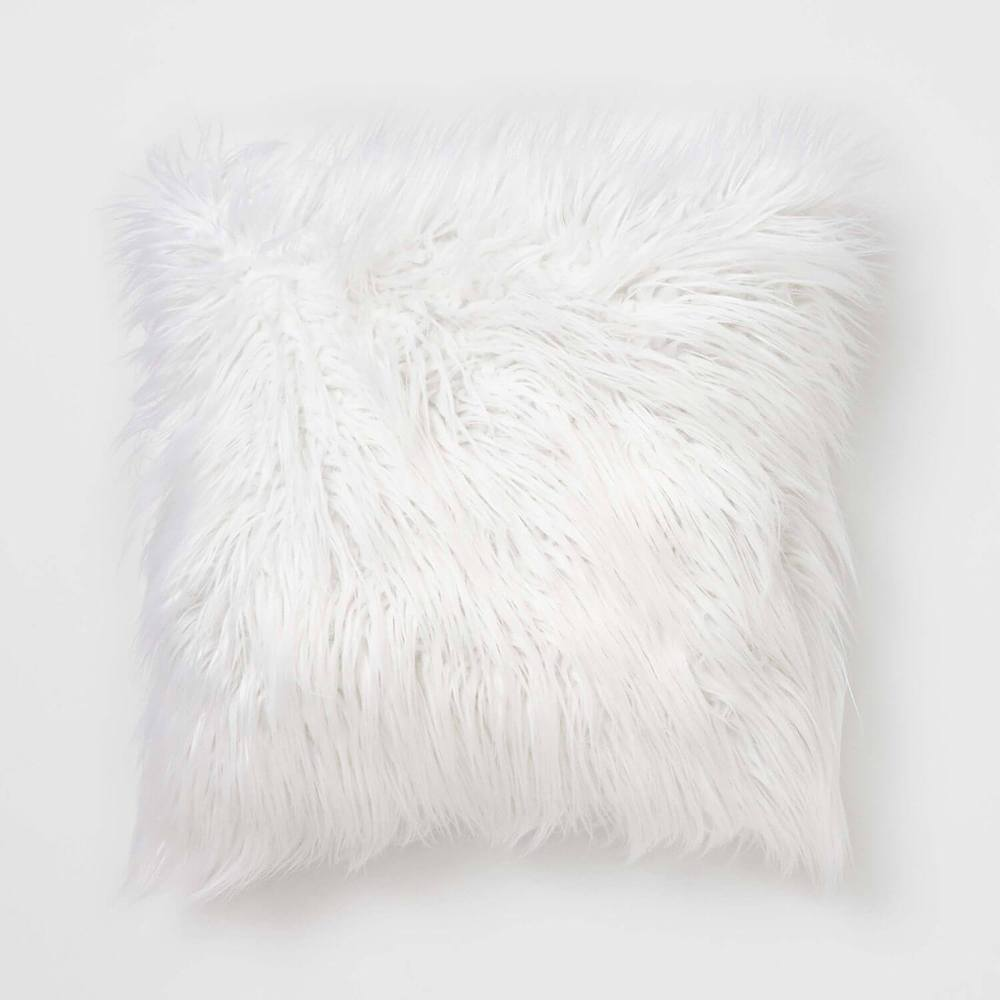 White faux mongolian fur pillow for dorm rooms from Dormify