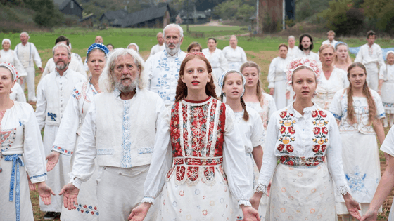 Midsommar movie costumes - swedish commune members wear white embroidered clothing