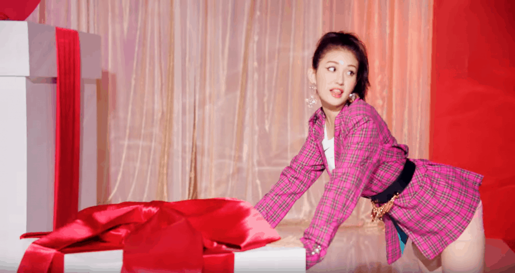 Somi fashion in her Birthday music video - shot of Jeon Somi wearing pink plaid dress