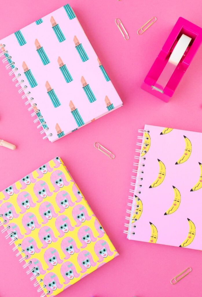 patterned notebooks on pink background