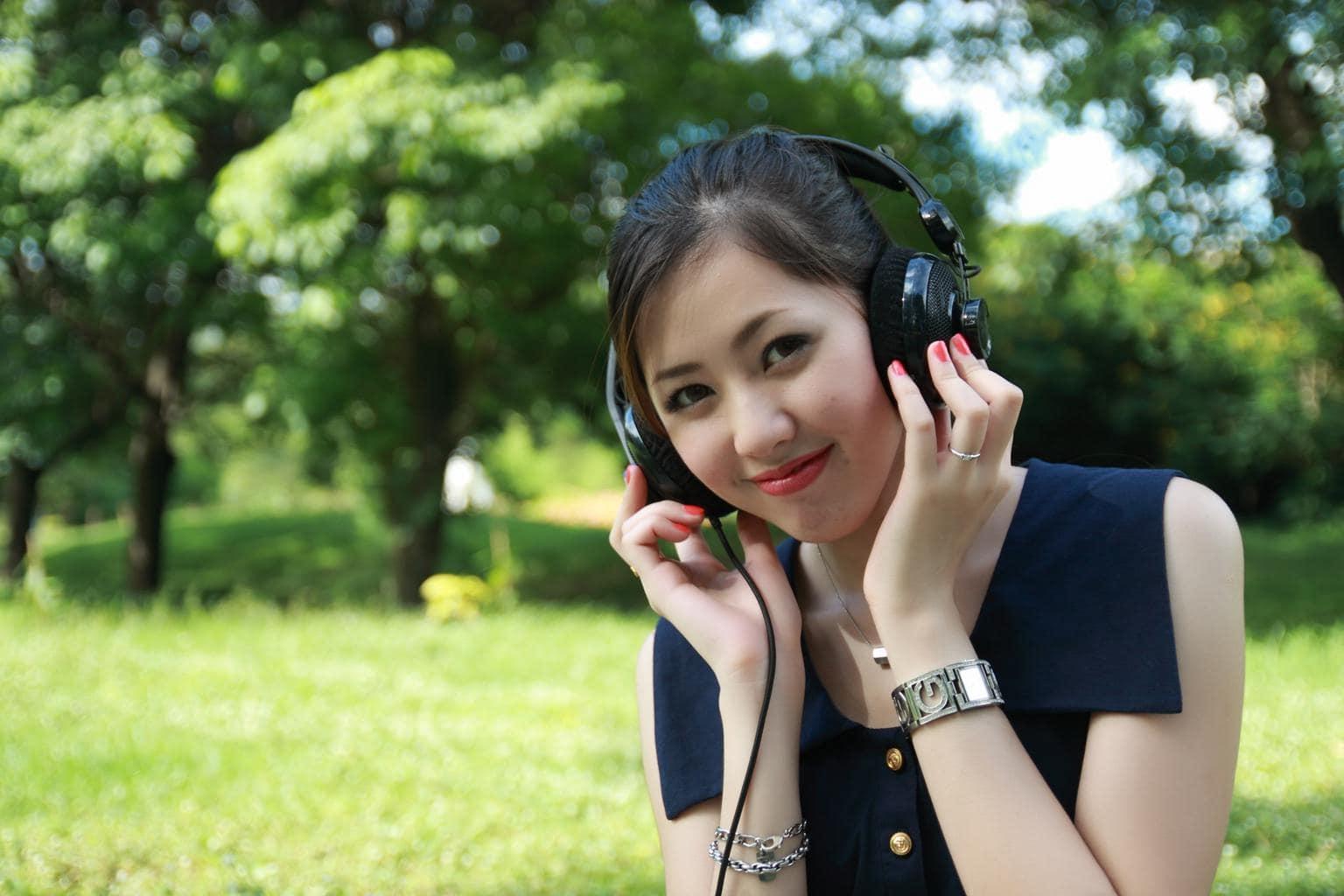 girl listening to music through headphones