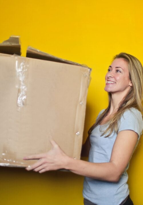 What not to bring to college - girl holding a box