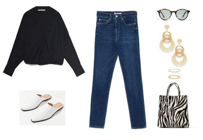 Skinny jeans outfit idea with white mules, black sweater, zebra tote bag, gold jewelry