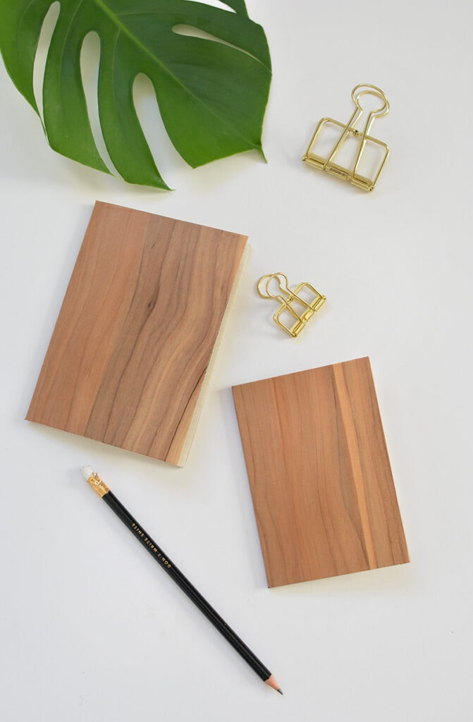 fake wood notebook with metal clips and leaf
