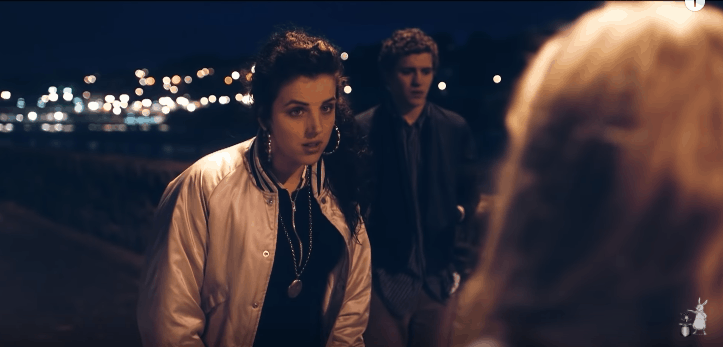 Michelle on Derry Girls wearing a bomber jacket