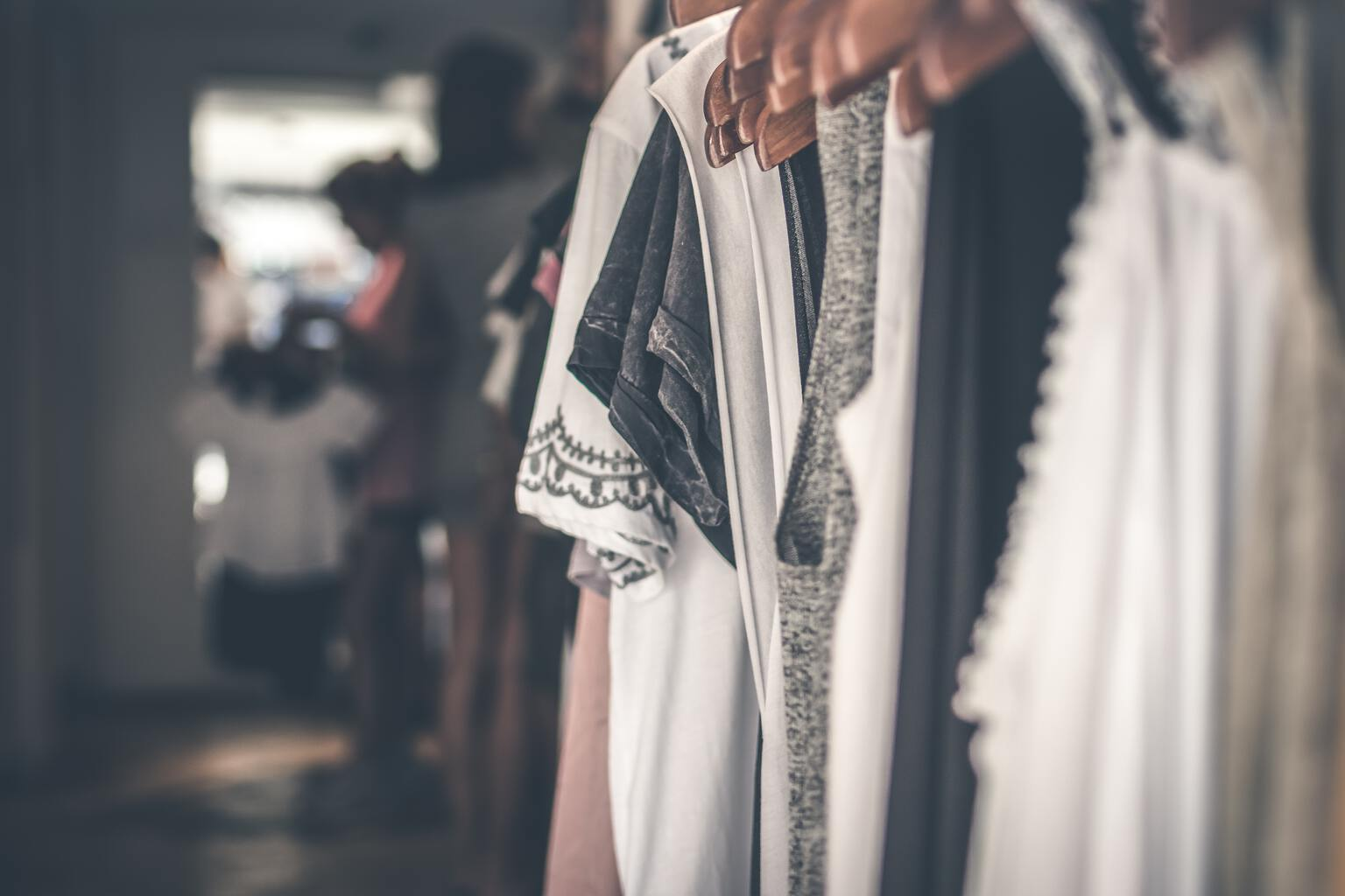 Womens clothing on hangers.