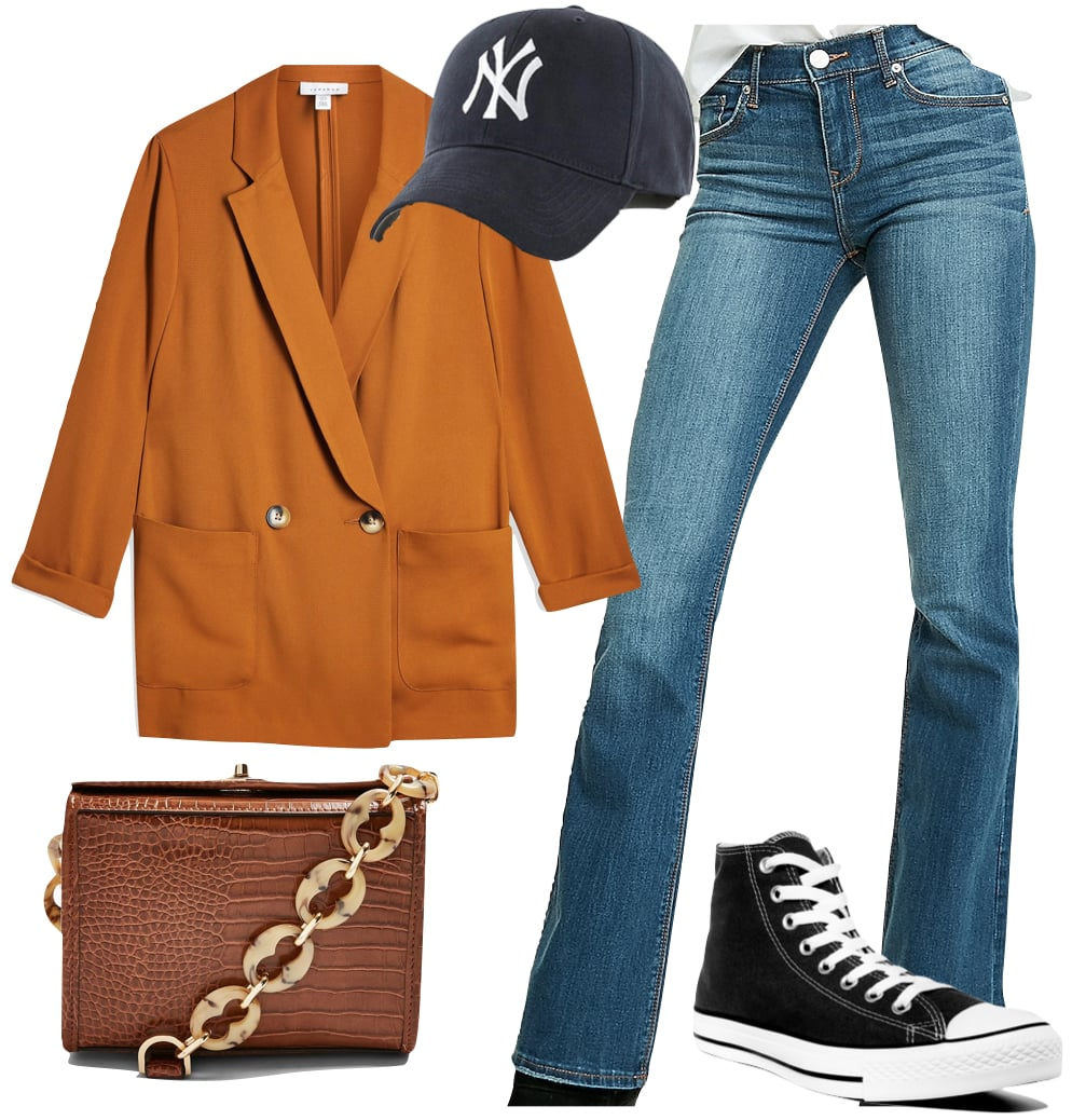 Kaia Gerber Outfit #3: orange oversized blazer, Yankee baseball cap, bootleg jeans, brown crocodile shoulder bag with chain strap, and black Converse Chuck Taylor high top sneakers