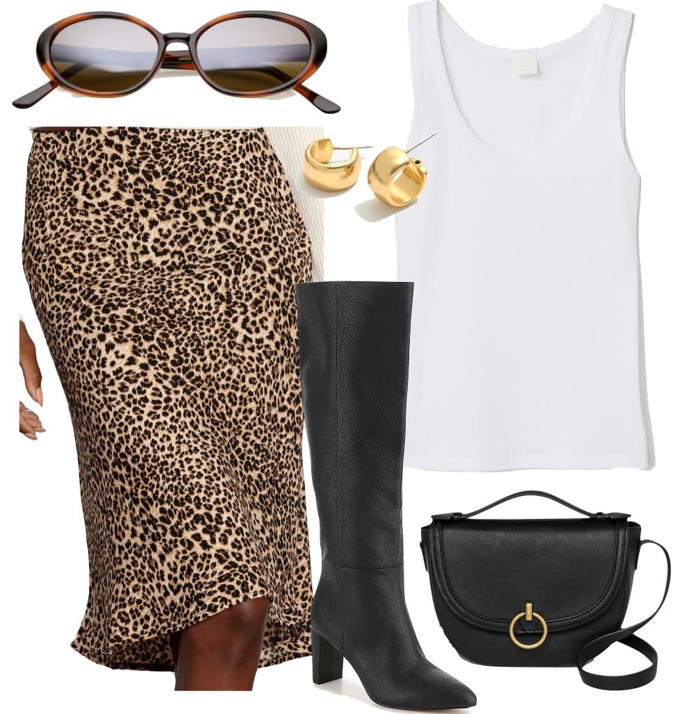 Kaia Gerber Outfit: white tank top, leopard print knee length skirt, black knee high boots, chunky mini gold hoop earrings, mirrored tortoise sunglasses, and a black saddle bag